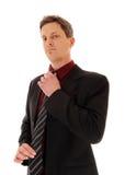 Businessman fixing his tie. Royalty Free Stock Photos