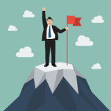 Businessman with flag on a Mountain peak Royalty Free Stock Photos
