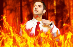 Businessman in flames: stressed by troubles Stock Images