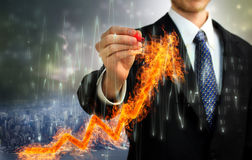 Businessman with Flaming Arrow Royalty Free Stock Photography