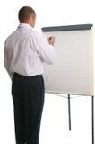 Businessman flip chart. Stock Images