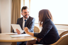 Businessman flirting with his coworker Stock Image