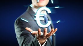 Businessman with a floating euro-symbol. Over his hand Royalty Free Stock Photography
