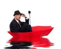 Businessman floating on umbrella Royalty Free Stock Image