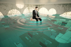Businessman in flooded office Stock Photos