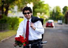 Businessman with flowers Royalty Free Stock Image