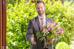 Businessman with Flowers Showing Handshake Gesture Royalty Free Stock Photography