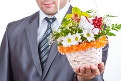 Businessman with flowers Stock Images