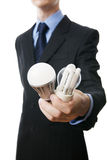 Businessman with fluorescent and LED lamps and incandescent Stock Photos