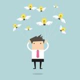 Businessman fly with idea bulb Stock Photos