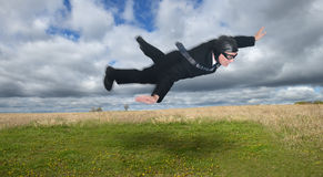 Businessman Fly Over Field and Meadow, Business an Royalty Free Stock Photography