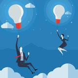 Businessman flying in air balloon with light bulb. Stock Image