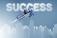 The businessman flying on airplane in success concept Stock Photos