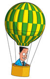 Businessman flying in balloon Royalty Free Stock Photography