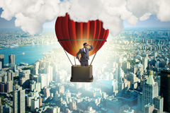 The businessman flying on balloon in challenge concept. Businessman flying on balloon in challenge concept Royalty Free Stock Photography
