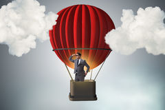 The businessman flying on balloon in challenge concept Stock Photos