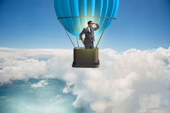 The businessman flying on balloon in challenge concept Royalty Free Stock Image