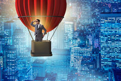The businessman flying on balloon in challenge concept Stock Image