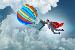 The businessman flying on balloon in challenge concept Royalty Free Stock Photography