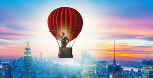 The businessman flying on balloon in challenge concept Royalty Free Stock Photo