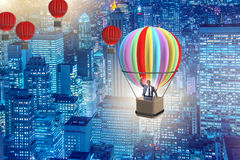 The businessman flying on balloon in challenge concept. Businessman flying on balloon in challenge concept Royalty Free Stock Photos