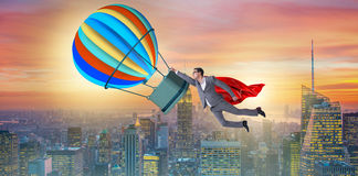 The businessman flying on balloon in challenge concept Stock Photo