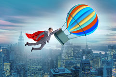The businessman flying on balloon in challenge concept. Businessman flying on balloon in challenge concept Stock Images