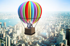 The businessman flying on balloon in challenge concept. Businessman flying on balloon in challenge concept Royalty Free Stock Photo