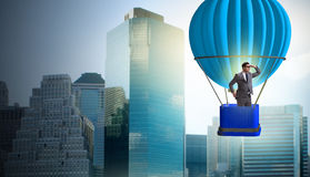 The businessman flying on balloon in challenge concept. Businessman flying on balloon in challenge concept Royalty Free Stock Images