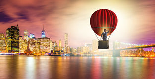 The businessman flying on balloon in challenge concept. Businessman flying on balloon in challenge concept Stock Photography