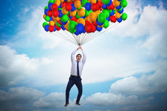 The businessman flying on balloons in challenge concept Royalty Free Stock Photography