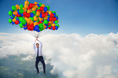 The businessman flying on balloons in challenge concept Royalty Free Stock Image