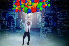 The businessman flying on balloons in challenge concept Royalty Free Stock Images