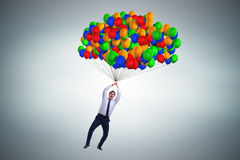 The businessman flying on balloons in challenge concept Royalty Free Stock Photos