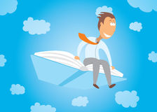 Businessman flying on a book Royalty Free Stock Photos