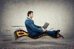 Businessman flying carpet stock image