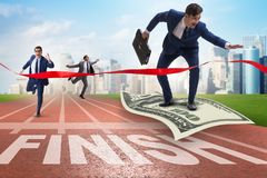 The businessman flying on dollar banknote towards finish line. Businessman flying on dollar banknote towards finish line Royalty Free Stock Photo