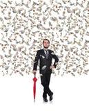 Businessman flying dollar bills Stock Images