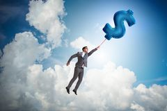 The businessman flying on dollar sign inflatable balloon. Businessman flying on dollar sign inflatable balloon Royalty Free Stock Photo