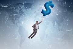 The businessman flying on dollar sign inflatable balloon. Businessman flying on dollar sign inflatable balloon Stock Photography