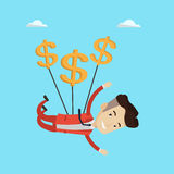 Businessman flying with dollar signs. Stock Photo