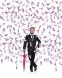 Businessman flying euro bills Stock Photos