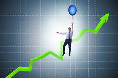 The businessman flying on hot balloon over graph Stock Photography