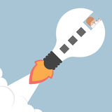 Businessman flying with a idea rocket Stock Image