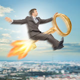 Businessman flying on key Royalty Free Stock Photo