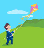 Businessman Flying a Kite Stock Photo