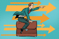 Businessman flying on a leather business briefcase Royalty Free Stock Image