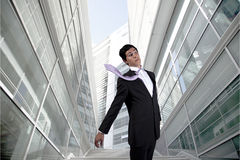Businessman with a flying necktie Stock Photography