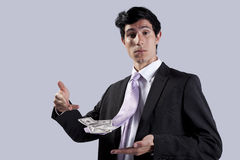 Businessman with a flying necktie with money Stock Images