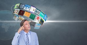 Businessman with flying panels over head Stock Photo